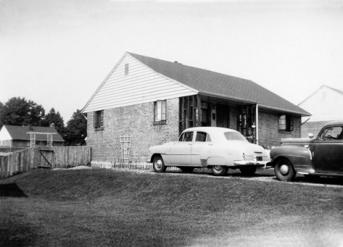 Our house in 1954. The Bush place is seen behind it.