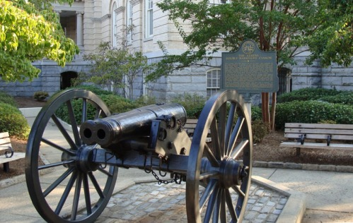 The double-barreled cannon stands silent watch in Athens, Georgia.