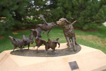 """City Dog,"" a statue in Colorado dedicated to hunters who heed the voices."
