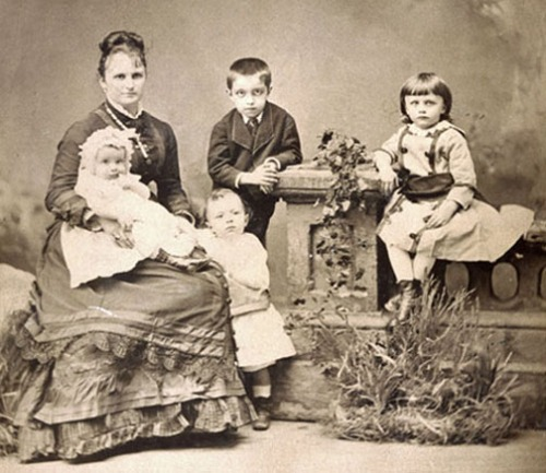 Author Chopin in 1877 with four of her five children.