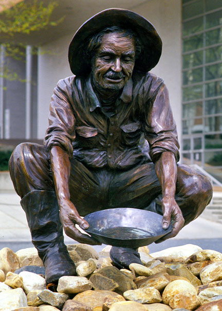 "This statue at the University of North Carolina at Charlotte commemorates the area's gold-mining heritage. ""Norm the Niner"" is the school mascot."