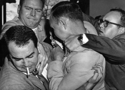 Carter (lower left) is attacked by former Klan associates in 1957 after his acquittal on charges of shooting two of them.
