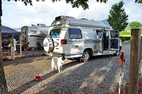 Paco and Old Blue at [name redacted] RV Park. That's Joan and Bob's campsite on the far side of my van.