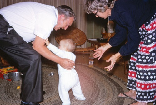 On a visit to Suwanee in April 1972, Mom and Dad help my son Dustin take his first steps.