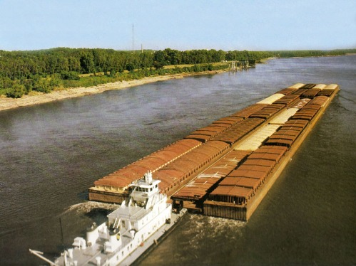 A towboat pushes barges down the Mississippi River.