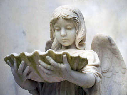 The child angel holding a shell. My personal favorite.