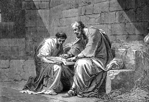 St. Paul the Apostle in prison, writing an epistle to admonish the Ephesians.