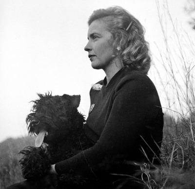 Brown with Crispian, her Kerry Blue Terrier.