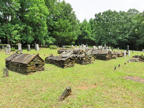 Hebron Cemetery was established in 1802 and features 15-20 above-ground burial vaults from the early days. 20 veterans of the American Revolution are buried at Hebron.